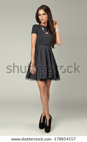 Attractive model wearing beautiful dress - stock photo