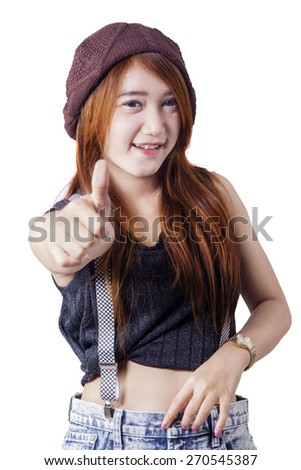 Attractive modern teenage girl showing OK gesture at the camera, isolated on white background - stock photo