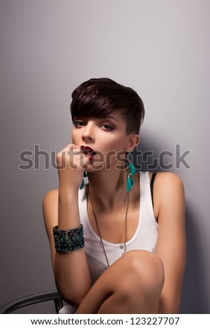 Attractive Modern Woman with Bob Hairstyle Daydreaming - stock photo