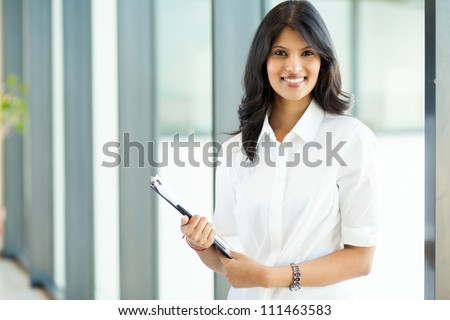 attractive modern young indian businesswoman in office - stock photo