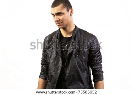 Attractive mulatto in a leather jacket on isolated studio background. - stock photo
