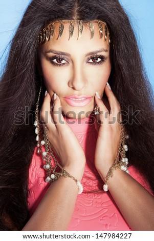 Attractive multi ethnic beautiful woman looking at camera , posing. - stock photo