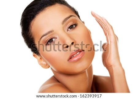 Attractive naked woman. Hands close to face. Closeup on face. Isolated on white.  - stock photo