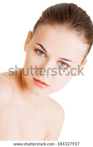 Attractive naked woman. Holding her breasts. Closeup. Isolated on white.  - stock photo
