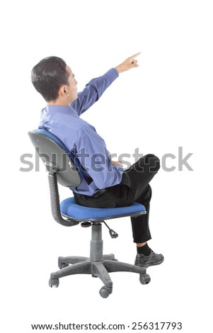 attractive of businessman sitting and pointing - stock photo