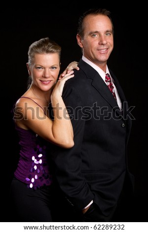 Attractive older formal couple together - stock photo