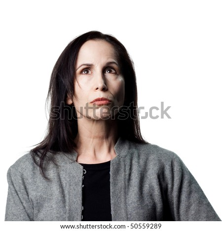 Attractive older woman looking to the heavens - stock photo