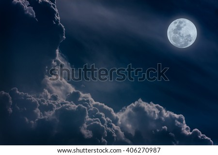 Attractive photo of a nighttime sky with clouds, bright full moon would make a great background. Nightly sky with large moon. Beautiful nature use as background. Outdoors. - stock photo