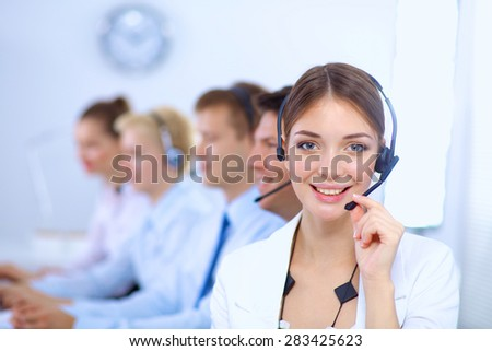 Attractive positive young businesspeople and colleagues in a call center office. - stock photo