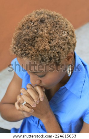 Attractive Professional African American Business Woman Person Black Hair Praying Wearing a Blue Shirt Christian Christianity  - stock photo