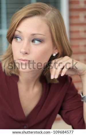 Attractive Professional Business Woman Thinking While Looking to the Side - stock photo
