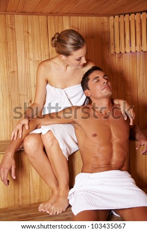 Attractive relaxed couple enjoying a sauna treatment together - stock photo