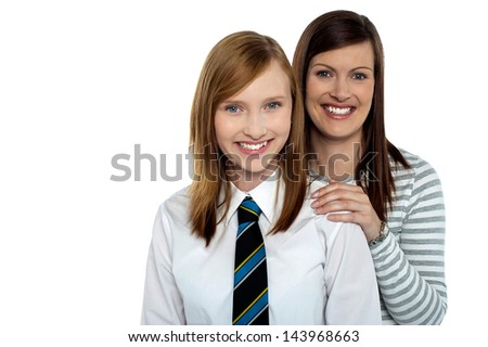 Attractive schoolgirl with her cheerful mother - stock photo