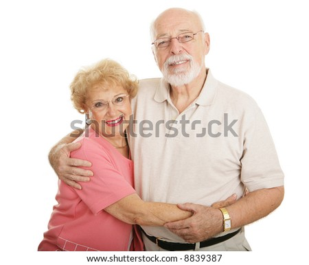 Attractive senior couple wearing new glasses.  Isolated on white. - stock photo
