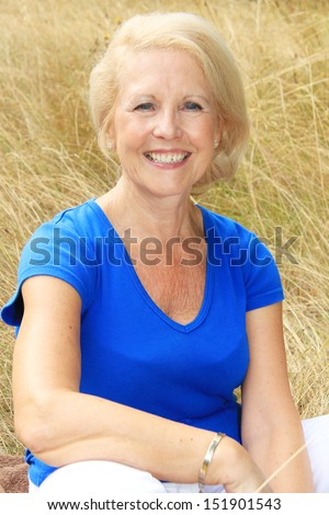 Attractive senior lady outside.  - stock photo
