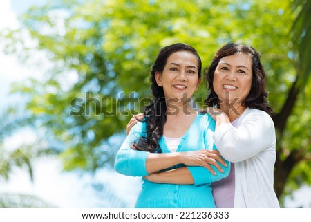 Attractive senior Vietnamese women looking at the camera - stock photo