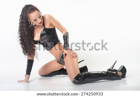 attractive sexy girl posing in fetish wear. More outfits in photo set - stock photo