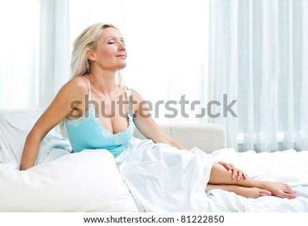 attractive sexy mature woman in her bed - stock photo