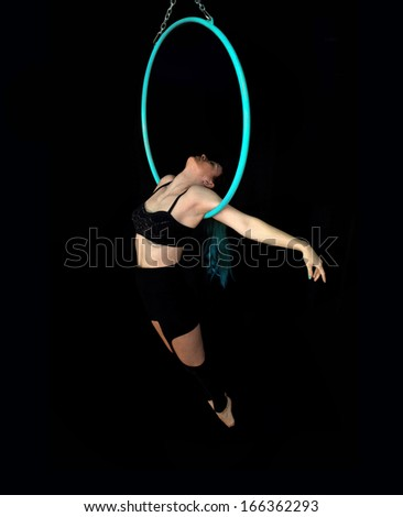 attractive sexy woman performing element on Aerial hoop - stock photo