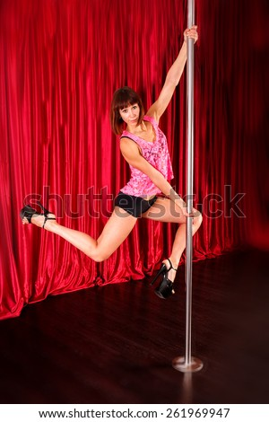attractive sexy woman pole dancer performing on stage - stock photo