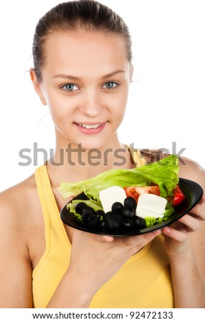 attractive sexy young woman eat healthy vegetarian salad, girl holding a plate of greek salad, smiled young caucasian woman on diet and loss weight, isolated on white background - stock photo