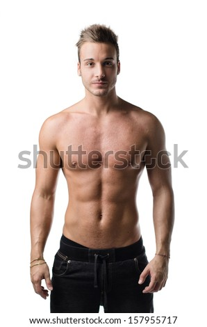 Attractive , shirtless young man with muscular body, showing pecs, abs and arms, isolated on white - stock photo