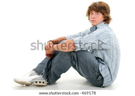 Attractive Sixteen Year Old Teen Boy In Casual Clothes Over White.  Light brown curly hair and hazel eyes. - stock photo