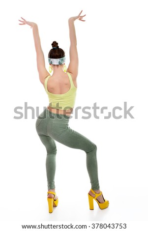 Attractive slim teen girl posing in studio. Full length portrait of young fashion woman. Fitness dancing girl. - stock photo