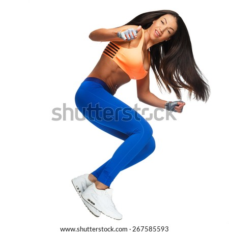 Attractive slim woman with dark long hair in a jump. Isolated on white - stock photo