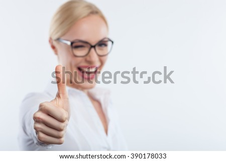 Attractive smart girl is expressing positive emotions - stock photo