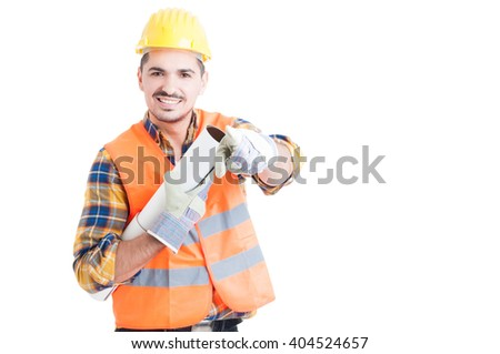 Attractive smiling engineer with helmet pointing finger on you while holding blueprint isolated on white background with copyspace - stock photo