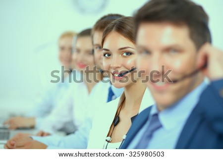 Attractive Smiling positive young businesspeople and colleagues in a call center office - stock photo