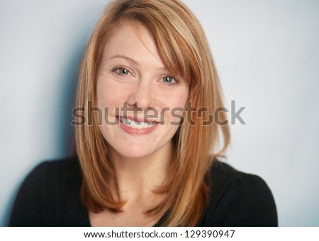 Attractive smiling woman closeup portrait - stock photo