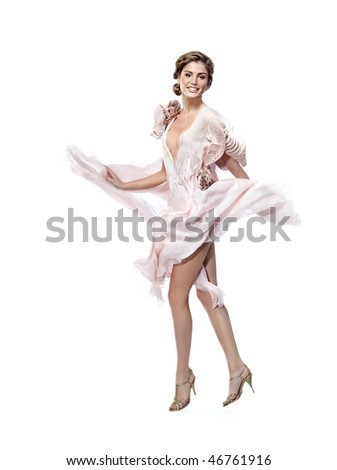 attractive smiling woman in pink dress on white background - stock photo