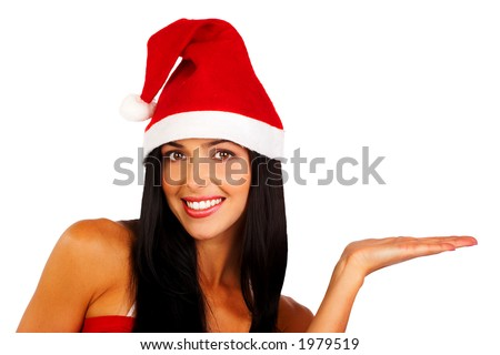 Attractive smiling woman in Santa Cap holding something - stock photo