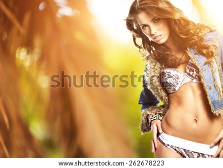 attractive smiling woman portrait on tropical beach - stock photo