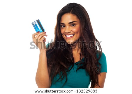 Attractive smiling young model holding up her credit card. - stock photo