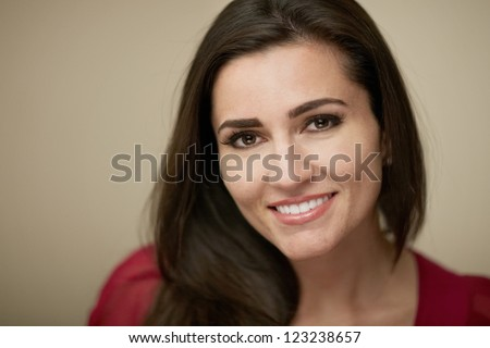 Attractive smiling young woman closeup portrait - stock photo