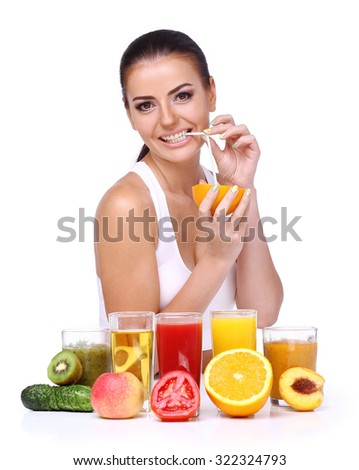 Attractive smiling young woman drinking orange juice straight from fruit. Diet and vegetarian concept - happy woman with healthy food on an isolated white background. - stock photo