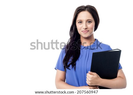 Attractive smiling young woman executive with folder - stock photo