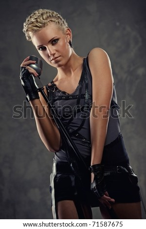 Attractive steam punk singer - stock photo