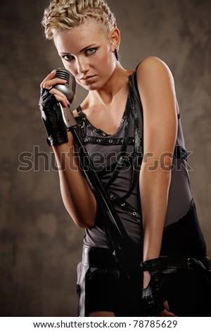 Attractive steam punk singer - stock photo