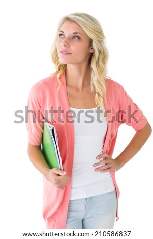 Attractive student holding notepads and thinking on white background - stock photo