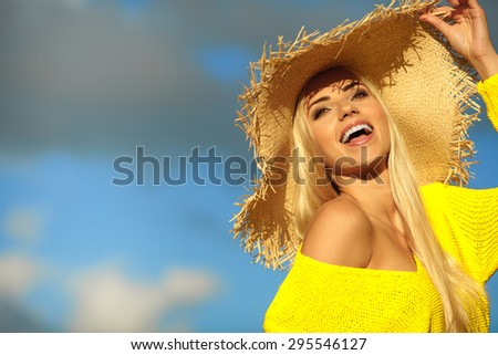 Attractive summer woman enjoying her time outside in park with blue sky  in background. - stock photo