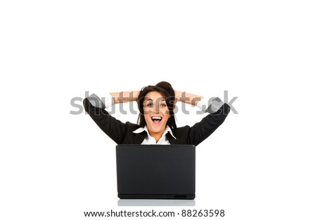 attractive surprised excited smile business woman hold hands on head sitting at the desk looking at camera, mouth open, isolated over white background, Winner businesswoman with success - stock photo