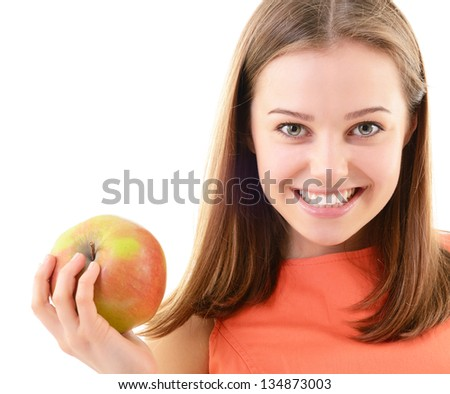Attractive teen girl holding an apple in her hand and happy smiling, looking at camera. Face closeup over white background - stock photo