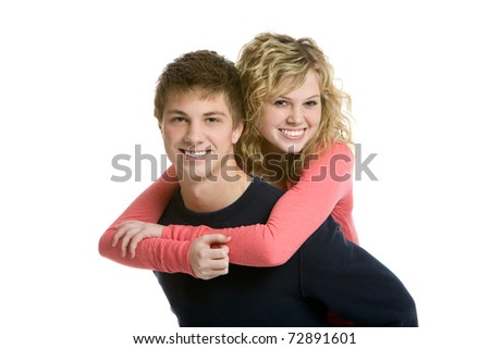 Attractive teenage couple, piggy back - stock photo