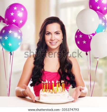 attractive teenage girl celebrating her birthday with cake - stock photo