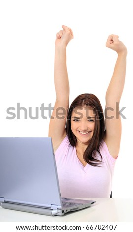 Attractive teenage girl cheering while using her notebook computer. All on white background. - stock photo