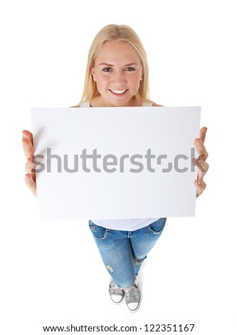 Attractive teenage girl holding blank white placeholder. All on white background. - stock photo